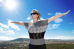 Woman spreading her arms on a sunny day Stock Photo