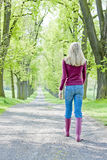 Woman in spring alley Royalty Free Stock Image