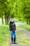 Woman in spring alley Stock Images