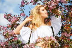 Woman in spring blossom park. Royalty Free Stock Images