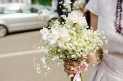 Woman with spring bouquet Stock Photo