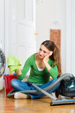 Woman at the spring cleaning. Young woman cleaning at home, she has a cleaning day and using a vacuum cleaner cleaning products and a bucket but she does not Stock Images