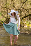 Woman in spring creek Stock Photo