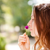 Woman with spring flower Stock Photos