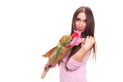 Woman with Spring Flower bouquet. Happy surprised model woman smelling flowers. Mother`s Day. Springtime. 8 march Royalty Free Stock Image