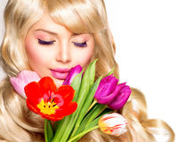 Woman with Spring Flowers Royalty Free Stock Photography