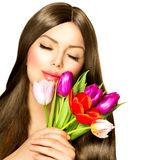 Woman with Spring Flowers. Royalty Free Stock Image