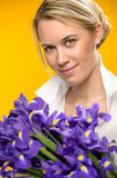 Woman with spring flowers purple iris Royalty Free Stock Photos