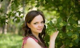 Woman in spring garden Stock Photo