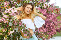 Woman in the spring garden among apple blossom. Stock Photo