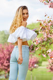 Woman in the spring garden among apple blossom. Royalty Free Stock Photos