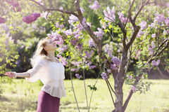 Woman in a spring garden Royalty Free Stock Images