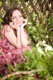 Woman in spring green garden Stock Image