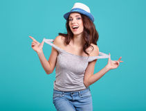 Woman with spring hat against blue background Stock Image