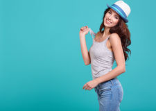 Woman with spring hat against blue background Stock Photography