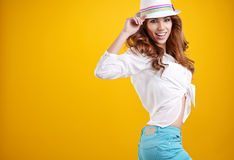 Woman with spring hat against yellow background Royalty Free Stock Photo