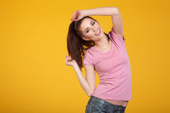 Woman with spring hat against yellow background Royalty Free Stock Image