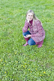 Woman on spring meadow Stock Photography