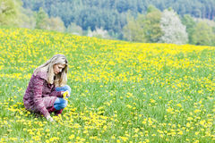 Woman on spring meadow Stock Photo