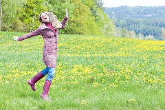Woman on spring meadow Royalty Free Stock Photos