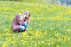 Woman on spring meadow Royalty Free Stock Photography