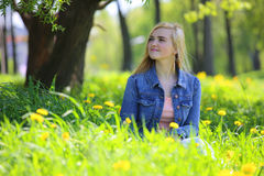 Woman in spring park Royalty Free Stock Images