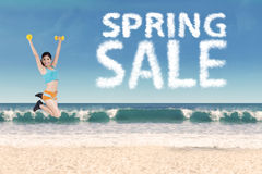 Woman with spring sale text shaped clouds Royalty Free Stock Images