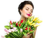 Woman with spring tulip flowers bouquet Stock Images
