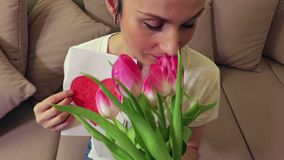 Woman with spring tulips in Mothers Day. Stock footage video stock footage
