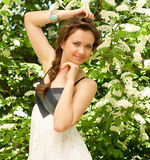 woman in spring white flowers Stock Photography