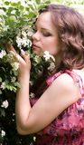 Woman in spring white flowers Stock Photo