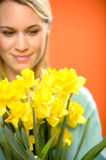 Woman with spring yellow flower narcissus Royalty Free Stock Image