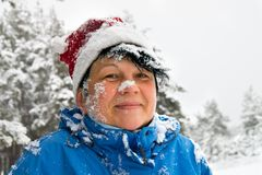 Woman sprinkled by a snow Royalty Free Stock Photography