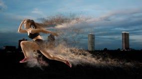 Woman sprinter leaving starting stock image