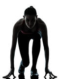 Woman sprinter on starting block Royalty Free Stock Image