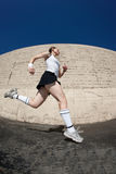 Woman sprints towards the finish line. Royalty Free Stock Photography