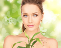 Woman with sprout and butterflies Royalty Free Stock Photography