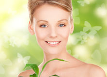 Woman with sprout and butterflies Royalty Free Stock Images