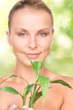 Woman with sprout and butterflies Stock Images