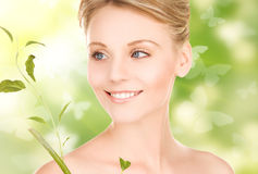 Woman with sprout and butterflies Royalty Free Stock Image