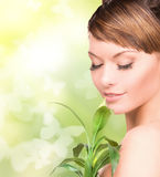 Woman with sprout and butterflies Stock Photography
