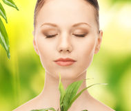 Woman with sprout Royalty Free Stock Photos