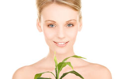 Woman with sprout Stock Photos