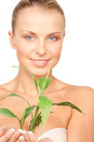 Woman with sprout Royalty Free Stock Images