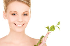 Woman with sprout Stock Images