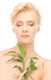 Woman with sprout Royalty Free Stock Photo