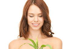 Woman with sprout Stock Photography