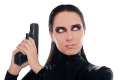 Woman Spy Holding Gun. Woman in a black leather suit holding a gun Royalty Free Stock Photos