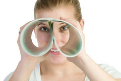 Woman spying through double roll of paper Stock Photography