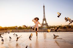 Woman on the square with beautiful view on the Eiffel tower in Paris stock photos